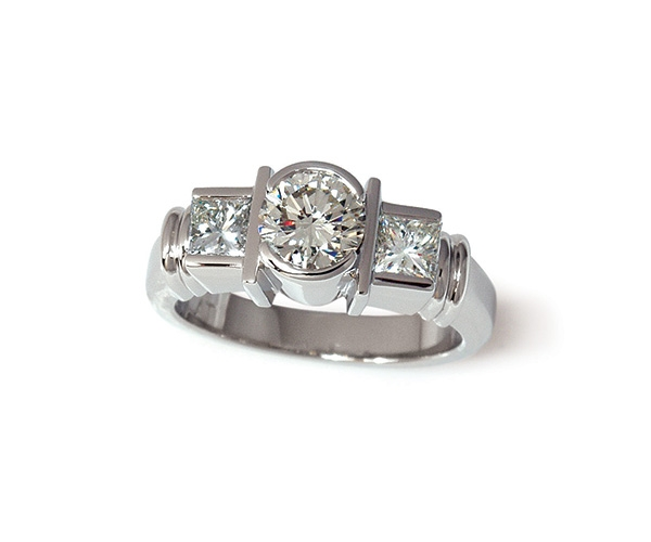 Round Brilliant and Princess Cut Three Stone Ring
