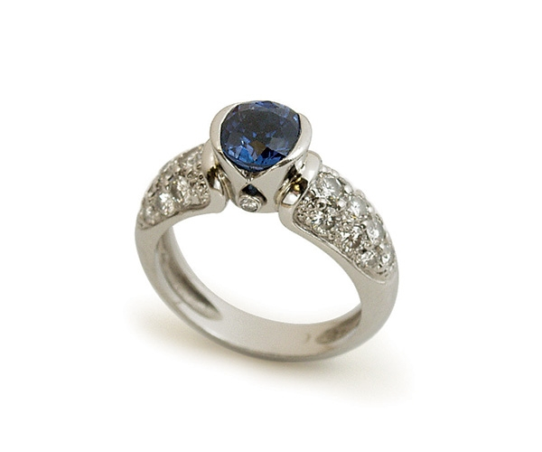 Blue Sapphire and Pave-set Diamonds in Platinum
